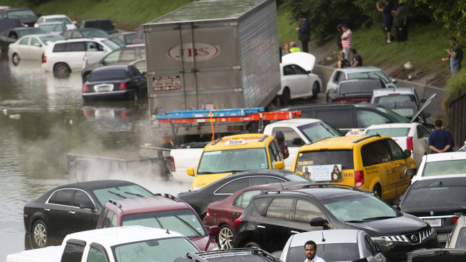 Motorists are  stranded along I-45 along North Main  in Houston after storms flooded the area, Tuesday, May 26, 2015. Overnight heavy rains caused flooding closing some portions of major highways in the Houston area. (Cody Duty/Houston Chronicle via AP)