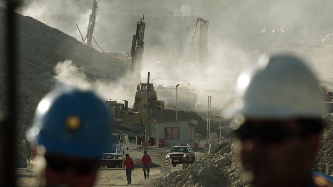 FILE - In this Aug. 9, 2010 file photo, a drill machine being used to try to contact 33 trapped miners stands in the distance in Copiapo, Chile. Chile marks on Sunday, Aug. 5, 2012 the two year anniversary since 33 miners were trapped in the mine that collapsed and trapped them for 69 days before their rescue. (AP Photo/Luis Hidalgo, File)