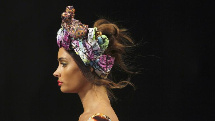 A model presents a creation from the brand Agua Bendita during Colombiamoda fashion show in Medellin