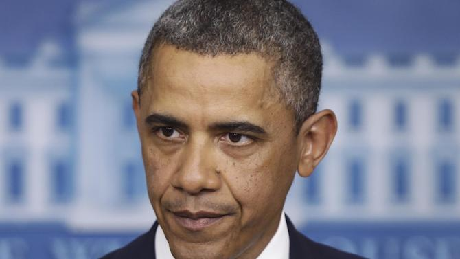 President Barack Obama pauses while he speaks to reporters in the Brady Press Briefing Room at the White House in Washington after meeting with Congressional leaders regarding the fiscal cliff, Friday, Dec. 28, 2012. (AP Photo/Charles Dharapak)