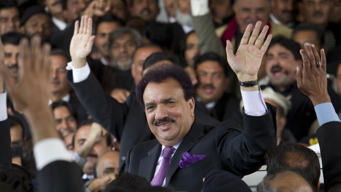 FILE - In this Thursday, Jan. 19, 2012 file photo, Pakistani interior minister Rehman Malik waves as he leaves the Supreme court in Islamabad, Pakistan. The court in recent months has targeted Pakistan's interior minister, Rehman Malik, on the citizenship issue. Malik resigned his Senate seat, renounced his British citizenship and won his seat back in a special election, but the court is still looking at prosecuting him for allegedly not revealing his full status when he first held the seat. (AP Photo/B.K. Bangash, File)