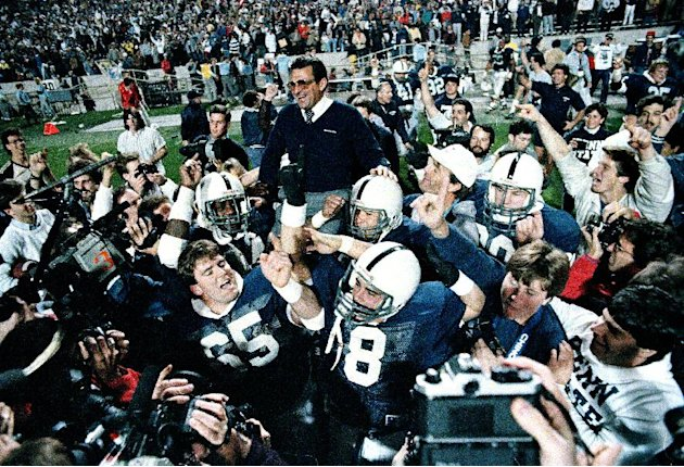 FILE - In this Jan. 2, 1987 file photo, Penn State coach Joe Paterno is carried after defeating Miami, 14-10,  in the Fiesta Bowl, to win the national championship, in Tempe, Ariz. Paterno say he plan