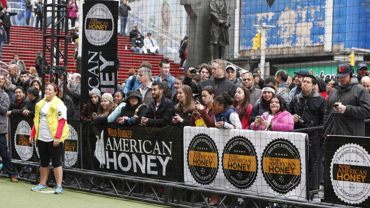 People watch the first ever American Honey Bar-sity Athletics kickball game in Times Square, on Tuesday, April, 23, 2013 in New York City, New York. (Photo by Mark Von Holden/Invision for American Honey/AP Images)