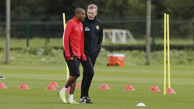 Manchester United's manager David Moyes talks with Ashley Young (Reuters)