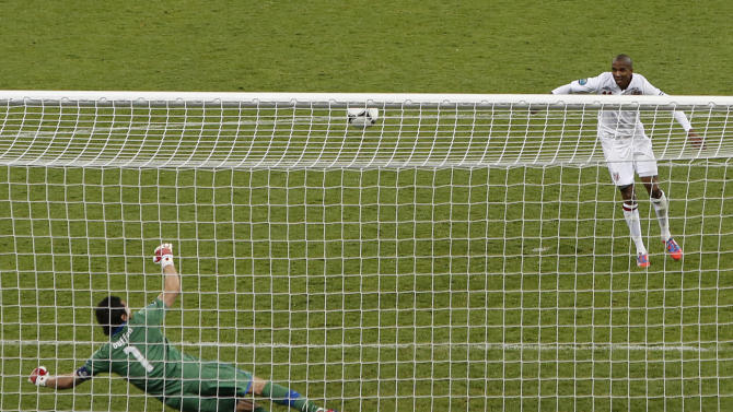 England's Ashley Young shots against the bar in the penalty shootout of the Euro 2012 soccer championship quarterfinal match between England and Italy in Kiev, Ukraine, Monday, June 25, 2012. (AP Photo/Efrem Lukatsky)