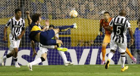 Osvaldo L) of Argentina's Boca Juniors attempts to score against Uruguay's Wanderers during their Copa Libertadores soccer match in Buenos Aires