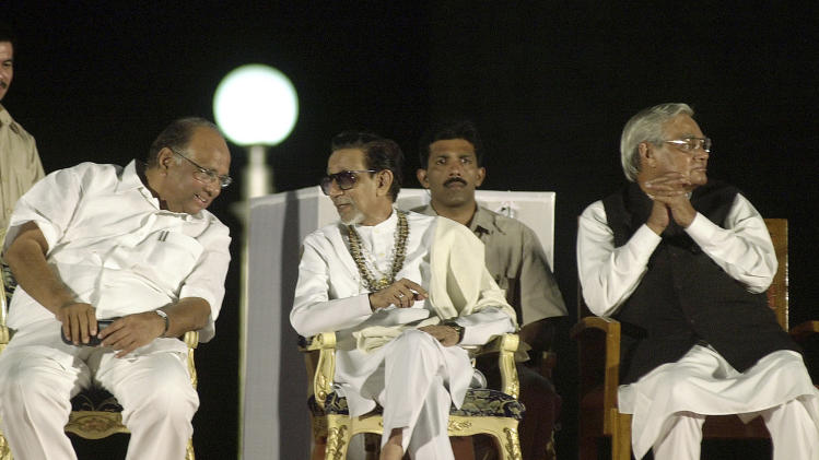 FILE- In this May 11, 2005 file photo, Hindu hardline Shiv Sena party leader Bal Thackeray, center, talks to Indian Agriculture Minister Sharad Pawar, left, at the release ceremony of a pictorial biography on his life, as former Indian Prime Minister Atal Behari Vajpayee looks on in Mumbai, India. Thackeray, the extremist leader linked to waves of mob violence against Muslims and migrant workers, has died Saturday, Nov. 17, 2012, after ailing for several weeks. He was 86. (AP Photo/Rajesh Nirgude, File)