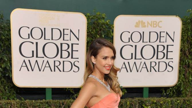 Actress Jessica Alba arrives at the 70th Annual Golden Globe Awards at the Beverly Hilton Hotel on Sunday Jan. 13, 2013, in Beverly Hills, Calif. (Photo by John Shearer/Invision/AP)
