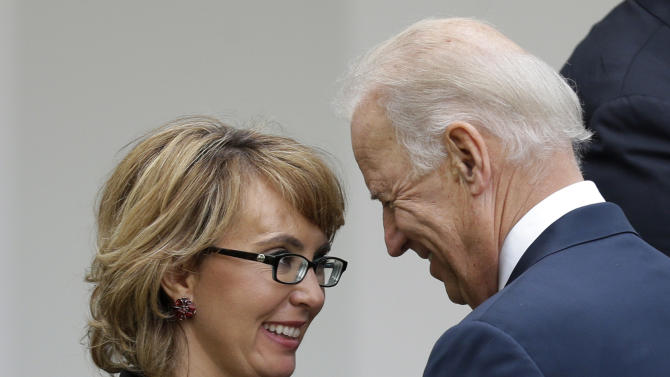 Former Rep. Gabby Giffords speaks with Vice President Joe Biden, at the end of a news conference held by President Barack Obama in the Rose Garden of the White House, in Washington, on Wednesday, April 17, 2013, about the defeat in the Senate of a bill to expand background checks on guns. (AP Photo/Manuel Balce Ceneta)