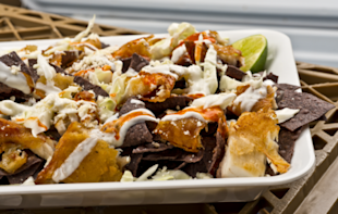 Sorry, coconut shrimp, Baja fish nachos are everyone's new favorite party food of the sea.