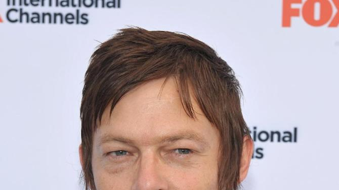 "COMMERCIAL IMAGE -  Norman Reedus attends  AMC's ""The Walking Dead"" Fox Breakfast on Friday July 13, 2012, in San Diego. (Photo by John Shearer/Invision for AMC/AP Images)"
