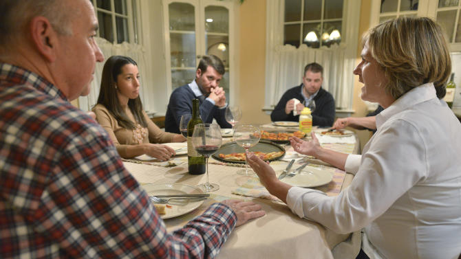 In this photo taken Friday, Nov. 16, 2012, Anne Brennan, right, of Hingham Mass., speaks as, from left, brother-in-law Steve Marshall, of Hingham, niece Rebecca Malone, and her husband Brian Malone, both of Duxbury, Mass., and nephew Andrew Marshall, of Quincy, Mass., are gathered for dinner in Hingham, Mass., where politics are a frequent, and divisive topic of conversation. (AP Photo/Josh Reynolds)