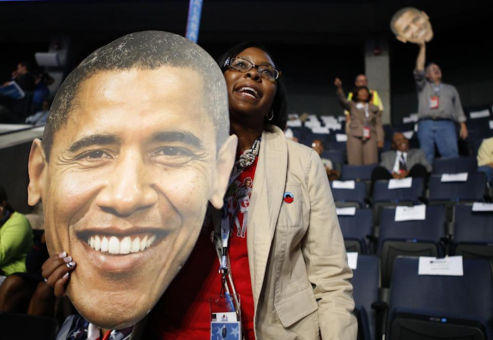 Indiana delegate Nicole Yates holds up a picture of President Barack Obama during the Democratic National Convention in Charlotte, N.C., on Wednesday, Sept. 5, 2012. (AP Photo/Jae C. Hong)