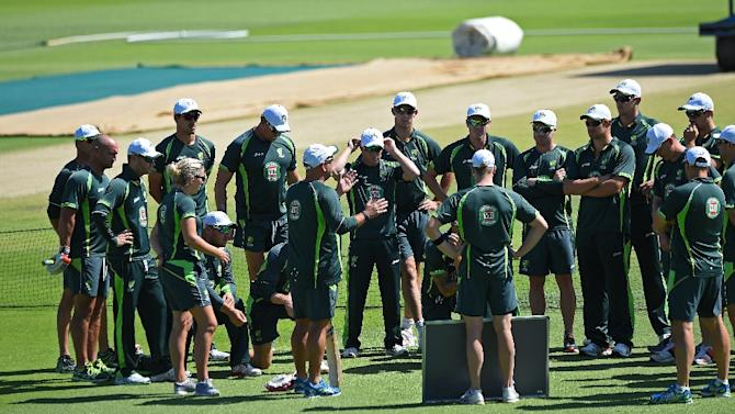 The Australian team gather near the pitch during a final training session in Perth on March 3, 2015