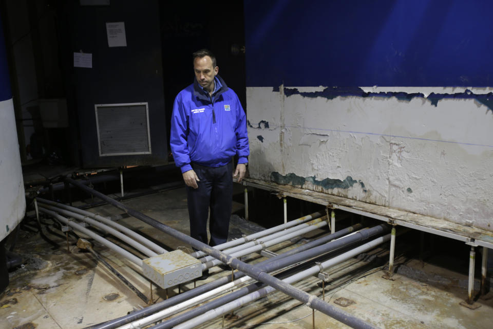 Director of the New York Aquarium, John Dohlin, looks around an exhibit ruined during Superstorm Sandy at the aquarium in Coney Island, New York, Monday, March 25, 2013.  (AP Photo/Seth Wenig)