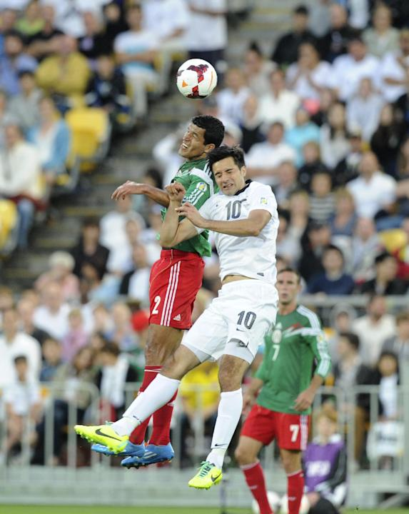 Mexico's Francisco Javier Rodriguez, left, and New Zealand's Rory Fallon contest a header during their World Cup qualifying soccer match at Westpac Stadium, in Wellington, New Zealand, Wednesday, Nov.