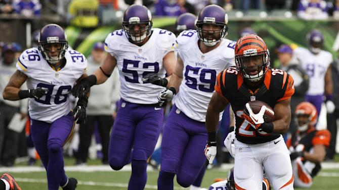 Cincinnati Bengals running back Gio Bernard (25) runs away from Minnesota Vikings safety Robert Blanton (36), outside linebacker Chad Greenway (52) and outside linebacker Desmond Bishop (59) during the second half of an NFL football game, Sunday, Dec. 22, 2013, in Cincinnati. Cincinnati won 42-14