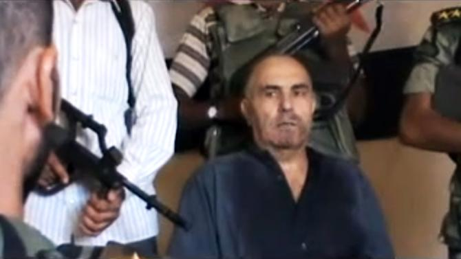 This image made from amateur video released by the Shaam News Network purports to show Syrian Pilot Colonel Rafik Mohammed Suleiman being interrogated by rebel officers after his Soviet-made MiG warplane was apparently hit by ground fire over Deir el-Zour province, an area near the Iraqi border, Syria, Monday Aug. 13, 2012.  If the rebel claim of the downing proves true, it could mark a significant jump in their ability to combat widening air attacks from President Bashar Assad's forces. (AP Photo/Shaam News Network) THE ASSOCIATED PRESS IS UNABLE TO INDEPENDENTLY VERIFY THE AUTHENTICITY, CONTENT, LOCATION OR DATE OF THIS HANDOUT PHOTO