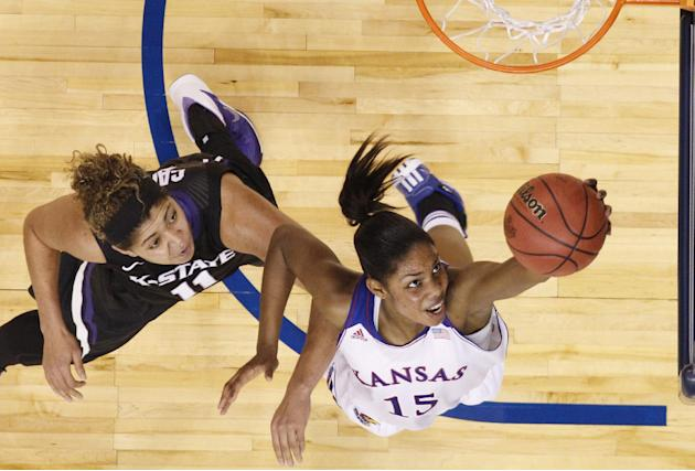 Kansas forward Chelsea Gardner (15) goes up for a shot in front of Kansas State forward Chantey Caron (11) in the first half of a Big 12 women's NCAA college basketball tournament game in Oklahoma
