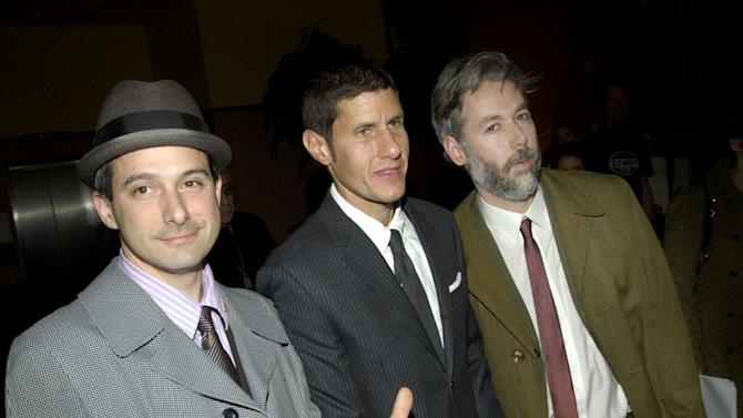 """FILE - In this March 28, 2006 file photo, members of the Beastie Boys, from left, Adam Horovitz, known as Adrock, Michael Diamond, known as Mike D and Adam Yauch, known as MCA, arrive at the premiere of their new film """"Awesome; I ... Shot That!"""" in New York.  The film, which documents a 2004 Beastie Boys concert at New York's Madison Square Garden, is comprised of footage shot by 50 fans who were given cameras to record the show. Yauch, the gravelly voiced Beastie Boys rapper who co-founded the seminal hip-hop group, has died at age 47. The cause of death wasn't immediately known. Yauch, who's also known as MCA, was diagnosed with a cancerous parotid gland in 2009. (AP Photo/Jason DeCrow, file)"""