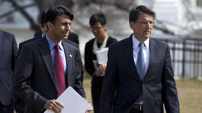 Louisiana Gov. Bobby Jindal, left, and North Carolina Gov. Pat McCrory, R-N.C., leave the White House in Washington, Monday, Feb. 25, 2013, for a National Governors Association (NGA) news conference following a meeting between the NGA and President Barack Obama. (AP Photo/Evan Vucci)