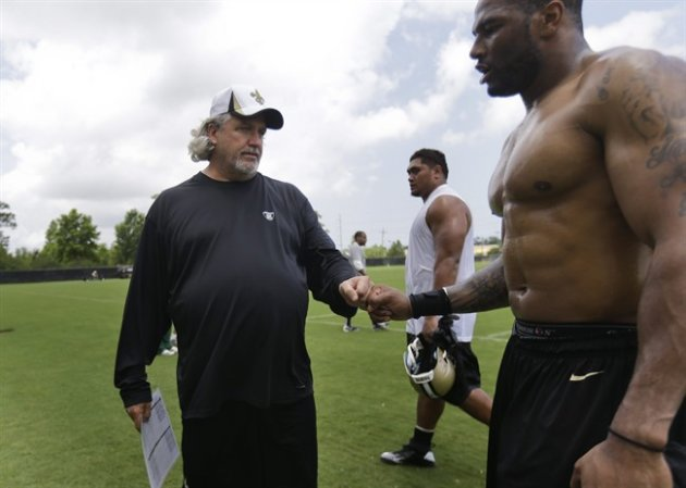 New Orleans Saints defensive coordinator Rob Ryan greets linebacker Victor Butler as he walks of the field after practice at their NFL football training facility in Metairie, La., Thursday, May 23, 20