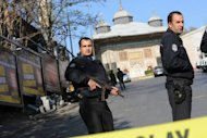 Turkish police stand guard after a gunman opened fire in a tourist area of Istanbul in November 2011. Turkish police have detained eight people in western Turkey over alleged links to the Al-Qaeda network, according to the Anatolia news agency