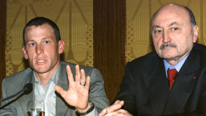 FILE - In this April 9, 2001, file photo, Lance Armstrong, left, appears during a news conference regarding doping accusations in Paris, as his lawyer Georges Kiejman watches. After a decade of denial and being stripped of his titles, Armstrong has finally come clean_ During an interview with Oprah Winfrey taped Monday, Jan. 14, 2013, Armstrong said he used performance-enhancing drugs to win the Tour de France cycling race, a person familiar with the situation told The Associated Press. (AP Photo/Laurent Rebours, File)