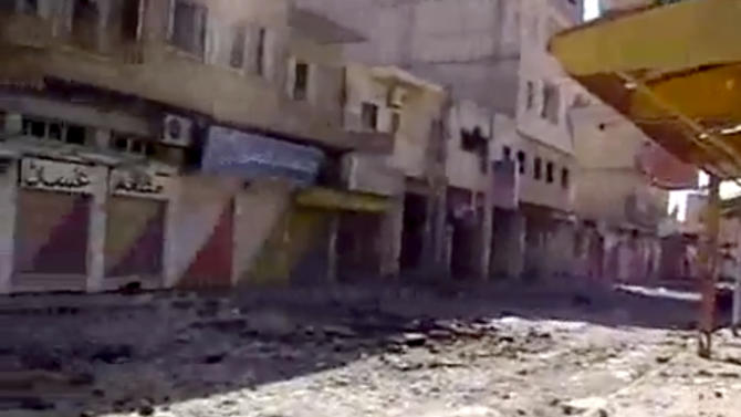 This image made from video provided by Deir Press Network and accessed by AP video on Thursday, Aug. 23, 2012 purports to show heavy damage from violence in Deir El-Zour, Syria. Across the country, scores of people died in shelling and clashes, according to the Britain-based Syrian Observatory for Human Rights and the Local Coordination Committees. The bloodshed coincided with the departure from the Syrian capital on Thursday of the last of the United Nations military observers after their mission headed by former U.N. Secretary General Kofi Annan, meant to help end the bloodshed in Syria, failed. (AP Photo/Deir Press Network via AP video) THE ASSOCIATED PRESS HAS NO WAY OF INDEPENDENTLY VERIFYING THE CONTENT, LOCATION OR DATE OF THIS PICTURE.