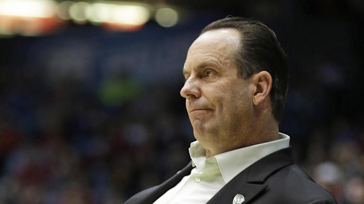 Notre Dame head coach Mike Brey watches the second half of a second-round game against Iowa State at the NCAA college basketball tournament on Friday, March 22, 2013, in Dayton, Ohio. (AP Photo/Al Behrman)