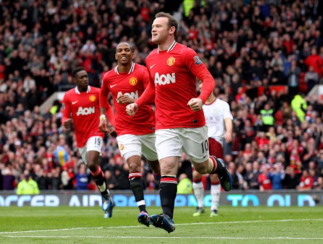 Our readers back Wayne Rooney and co. to win the 2012/13 EPL title. (Getty Images)