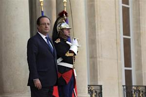 French President Hollande waits for a guest at the Elysee Palace in Paris