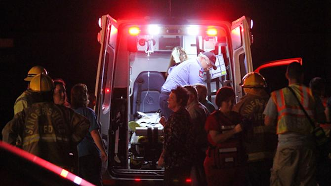 Emergency responders, members of Freedom Baptist Church, and Myrick community members in rural Jones County, Miss. gather near an ambulance outside the Freedom Baptist Church Wednesday night after a second floor youth room collapsed onto a first floor kitchen. Up to 35 youth ages from seventh grade to 12th grade were injured. A 16-year-old girl who suffered a head injury was airlifted to Forrest General Hospital in Hattiesburg. (AP Photo/The Chronicle, James Pugh)