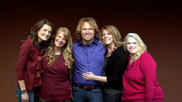 "FILE - In this file publicity photo provided by TLC, Kody Brown, center, poses with his wives, from left, Robyn, Christine, Meri and Janelle, in a promotional photo for the reality series, ""Sister Wives,"" which aired in March, 2011. When the polygamous family learned in December 2013 that a federal judge in Utah struck down key parts of the state's polygamy laws, Brown and his four wives said they cried and felt deeply emotional. The family says they are grateful for the ruling, but said winning the lawsuit they brought against Utah in July 2011 doesn't ease the pain caused by the significant personal sacrifices they made when they fled the state for Las Vegas under the threat of prosecution. (AP Photo/TLC, George Lange, File)"