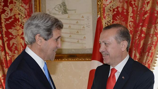 In this photo released by the Turkish Prime Minister's Press Office, Turkish Prime Minister Recep Tayyip Erdogan, right, and US Secretary of State John Kerry shake hands as they pose for cameras before a meeting in Istanbul, Turkey, Sunday, April 7, 2013. Kerry is in the Middle East, his third trip to the region in two weeks, in a fresh bid to unlock long-stalled Israeli-Palestinian peace talks. And in Istanbul, the first leg of a six-nation trip that goes on to Europe and East Asia, Kerry will coordinate with Turkey's Prime Minister and other Turkish officials on efforts to halt the violence in neighboring Syria's civil war.(AP Photo/Kayhan Ozer, Turkish Prime Minister's Press Office, HO)
