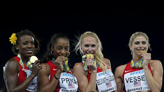 The U.S. women's 4x800 relay team celebrate with their gold medals after winning the event at the IAAF World Relays Championships in Nassau Bahamas