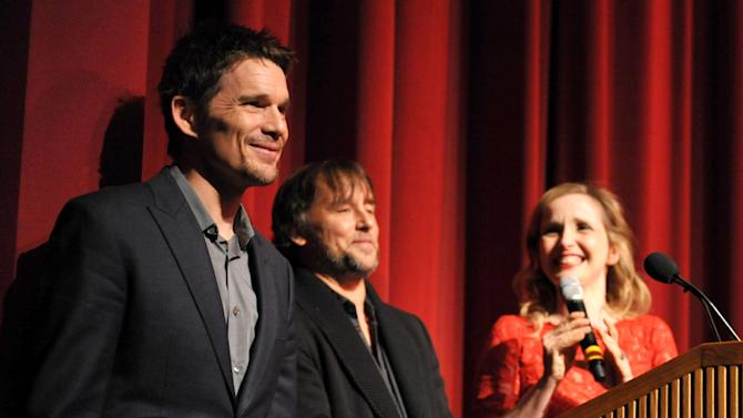 """IMAGE DISTRIBUTED FOR A-LIST COMMUNICATIONS - From left, Ethan Hawke, Richard Linklater, and Julie Delpy introduce the Sony PIctures Classics premiere of """"Before Midnight"""", on Tuesday, May 21, 2013 in Los Angeles. (Photo by John Shearer/Invision for A-List Communications/AP Images)"""