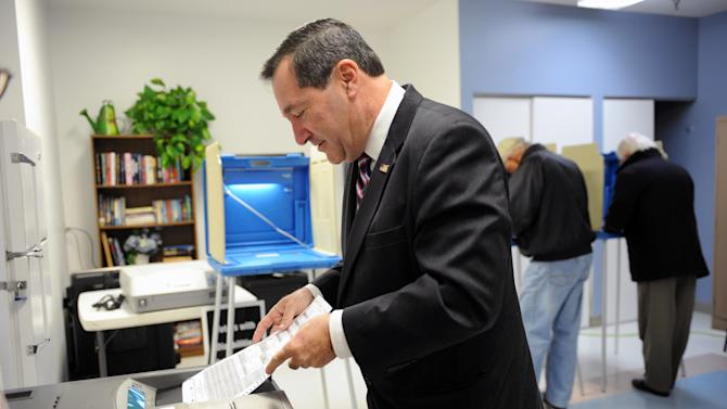 Joe Donnelly, Indiana Democratic candidate for U.S. Senate, casts his vote Tuesday Nov. 6, 2012 in South Bend, Ind. Donnelly is running for the Senate seat that was held by Republican Richard Lugar who lost in the primary to Richard Murdock.  (AP Photo/Joe Raymond)