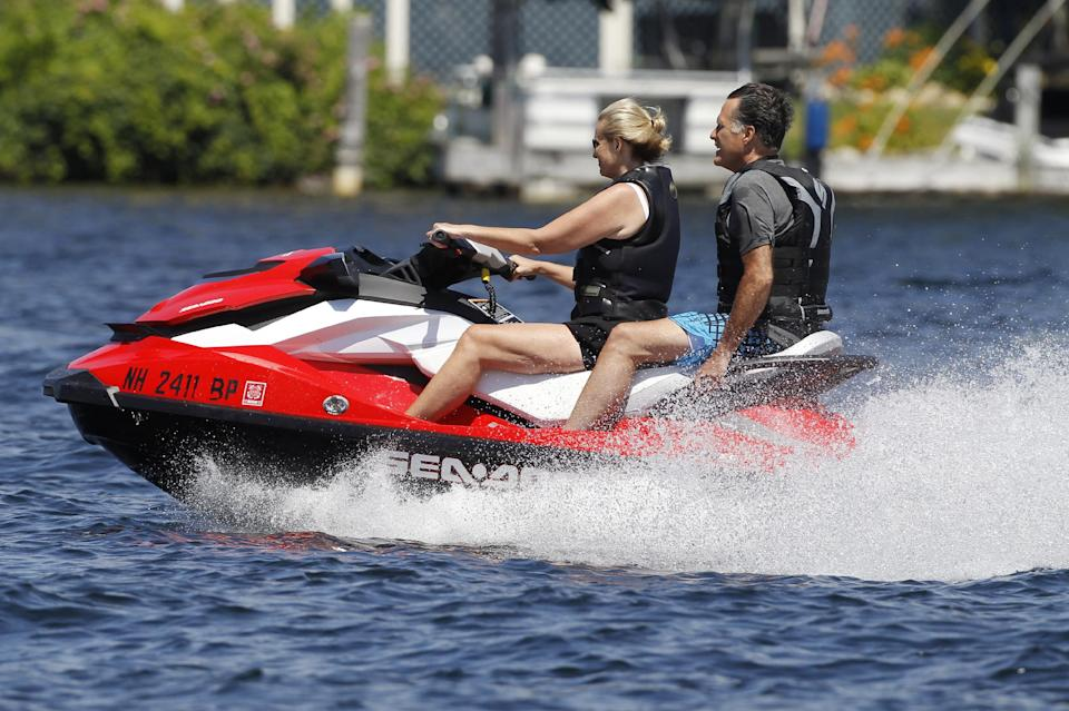 Republican presidential candidate, former Massachusetts Gov. Mitt Romney and wife Ann Romney jet ski on Lake Winnipesaukee in Wolfeboro, N.H., Monday, July 2, 2012, where Romney has a vacation home. (AP Photo/Charles Dharapak