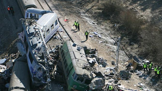 An aerial view  taken from a paraglider shows  the site of a train  crash near the town of  Szczekociny, southern Poland Sunday, March 4, 2012. Two trains collided head-on in southern Poland late Saturday, killing more than a dozen people and injuring more than 50 in what appears to be one of the worst rail disasters in the country in recent years, officials said. (AP/Photo/Grzegorz Misiak)  POLAND OUT