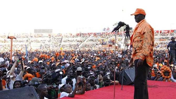 Orange Democratic Movement (ODM) Presidential candidate and current Prime Minister Raila Odinga addresses the crowd during a campaign rally at Nyayo National Stadium, Nairobi, Kenya, Saturday, March 2, 2013. Kenya's top two presidential candidates - Uhuru Kenyatta and Raila Odinga - held their final rallies Saturday before large and raucous crowds ahead of Monday's vote, which is the first nationwide election since Kenya's December 2007 vote descended into tribe-on-tribe violence that killed more than 1,000 people. (AP Photo/Khalil Senosi)