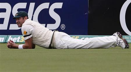 Australia's Harris looks on after taking a catch to dismiss England's Prior during the fifth day's play in the second Ashes cricket test at the Adelaide Oval