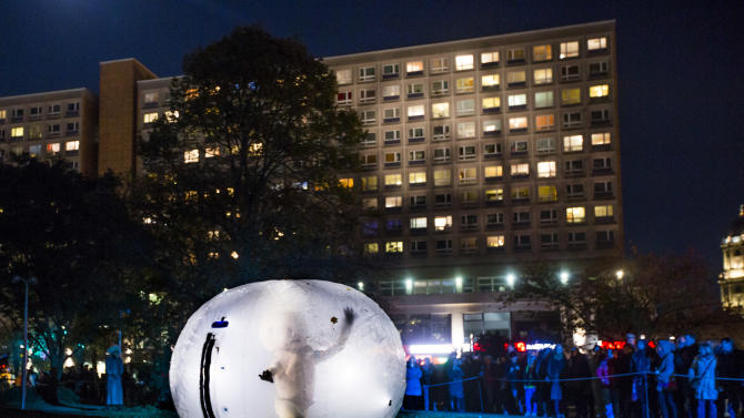 A member of the Titanick street art group performs during celebrations marking the 775th anniversary of the foundation of Berlin