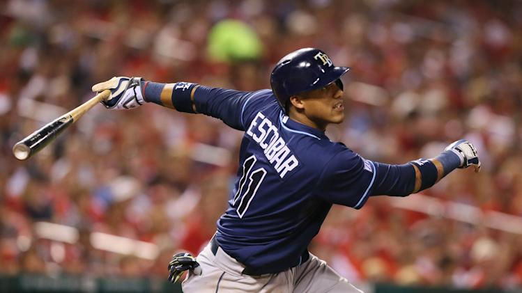 Tampa Bay Rays' Yunel Escobar drives in two runs with a ground-rule double in fifth inning againast the St. Louis Cardinals in a baseball game Tuesday, July 22, 2014, in St. Louis. The Rays won 7-2. (AP Photo/St. Louis Post-Dispatch, Chris Lee)