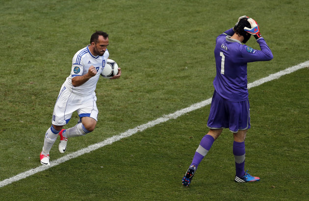 Greece's Fanis Gekas, left, celebrates scoring his side's first goal as Czech goalkeeper Petr Cech reacts during the Euro 2012 soccer championship Group A match between Greece and Czech Republic in Wroclaw, Poland, Tuesday, June 12, 2012. (AP Photo/Anja Niedringhaus)