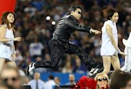 South Korean rapper Psy performs at halftime during the Seattle Seahawks NFL game against the Buffalo Bills at Rogers Centre on December 16, 2012. South Korean social networks and websites have been buzzing in recent days over a prediction attributed to the 16th century French seer Nostradamus that suggests Psy is not the smiling, benign 34-year-old rapper he appears