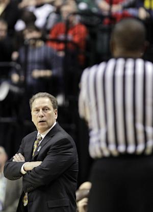 Michigan State head coach Tom Izzo talks to an official in the second half of an NCAA college basketball game against Wisconsin in the semifinals of the Big Ten Conference tournament in Indianapolis, Saturday, March 10, 2012. Michigan State won 65-52. (AP Photo/Michael Conroy)