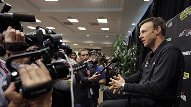 Matt Kenseth answers a question from the media during a news conference at Joe Gibbs Racing in Huntersville, N.C., Thursday, Jan. 24, 2013, as part of the NASCAR Sprint Cup Media Tour. (AP Photo/Chuck Burton)