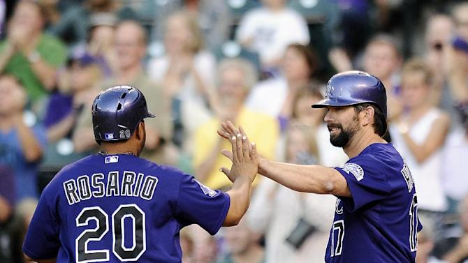 Chatwood's arm, bat lead Rockies over Brewers