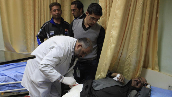 A man receives treatment at a hospital after being injured by a car bomb in the Shiite enclave of Sadr City, Baghdad, Iraq, Sunday, Feb. 17, 2013. A series of car bombs exploded within minutes of each other as Iraqis were out shopping in and around Baghdad on Sunday, killing and wounding scores of people, police said. (AP Photo/ Karim Kadim)